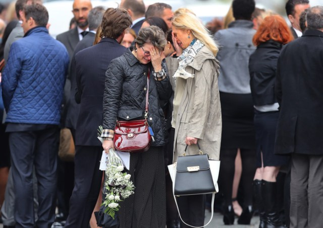 South Boston-05/12/2017- A funeral mass was held at the Gate of Heaven Church for Dr. Richard Field and Dr. Lina Bolanos, who were murdered in their condo in South Boston.  Mourners weep at the end of the service outside the church.
