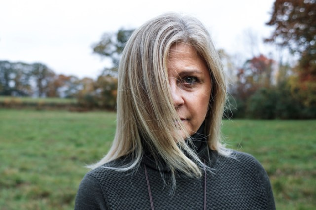 A strong gust of wind blows Robin Hempel's hair as she stands in the field behind her home in Gilmanton, NH, Tuesday, Oct. 24, 2017. Robin was prescribed the antidepressant Paxil 21 years ago and quitting was near impossible. She succeeded in her last attempt by tapering over months but experienced extreme withdrawal side effects.  The pharmaceutical industry has basically not been straight forward about the dangers of discontinuing anti-depression drugs.