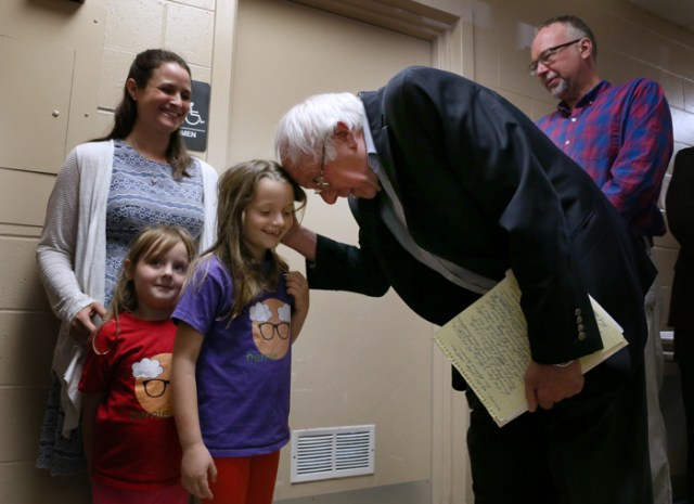 U.S. Sen. Bernie Sanders greets Mara Bridgett, 7, of Hooksett, N.H., as he arrives at the AFL-CIO Labor Day Breakfast at St. George Greek Orthodox Cathedral in Manchester, N.H., Monday, September 4, 2017.