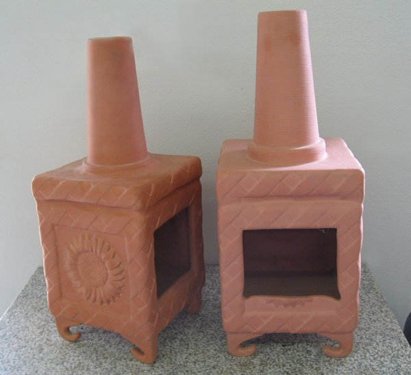 Fred's chiminea, created and assembled together from a variety of slipcast molds that usually produce: - tall glass (the chimney) - decorative tile (the sides and front) - coat hooks (the feet)