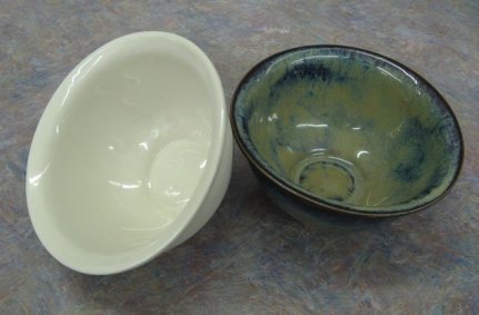 "These cereal/soup bowls are cast from the buff stoneware slip that Bracker's now makes and sells under the name ""Fred's Buff Stoneware."" Fred Dreher was so instrumental in the development and testing of the slip cast body that we just had to name it after him. Bowl on the left is glazed with clear, bowl on the right has a rutile glaze. Based on testing by several of Bracker's staff members, we can confirm that they really are the perfect size for soup, chili, salads, and so many other lunch-sized portions."