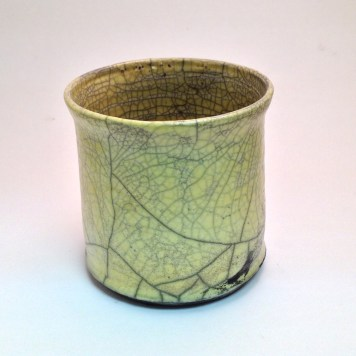 """backside of """"tattooed"""" pot showing excellent crackle of the glaze, , reduced in """"gerbil cage liner"""""""