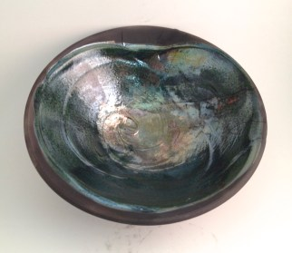 thrown bowl with textural slip added, glazed with Copper over slipped area only (form by Danny Meisinger)