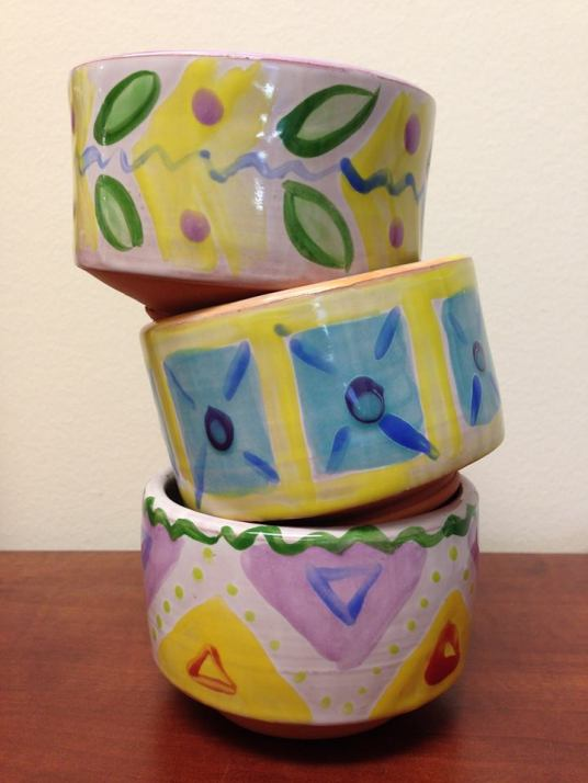 These bowls were thrown, trimmed and decorated by several different Amacans: we used 2 coats of white TP-11 or TC-11 as a base, then decorated with other TP colors in the Majolica tradition.