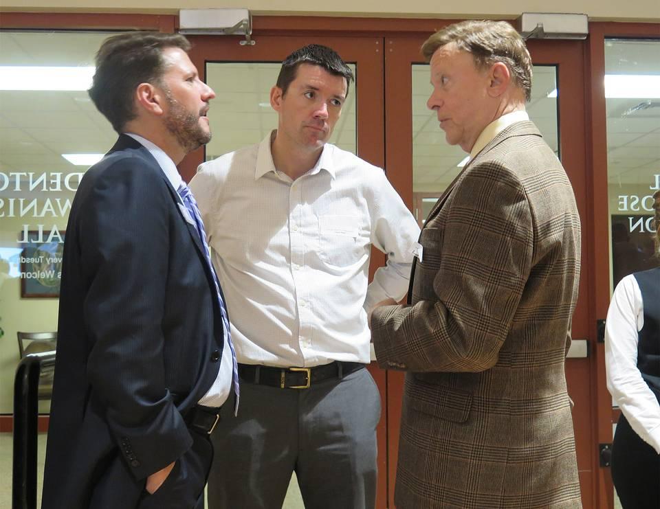 Manatee Chamber of Commerce board president Jonathan Fleece, left, and Inspiration Academy board member Ciaran Dwyer, center