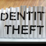 Shredder tearing up a document that says identity theft