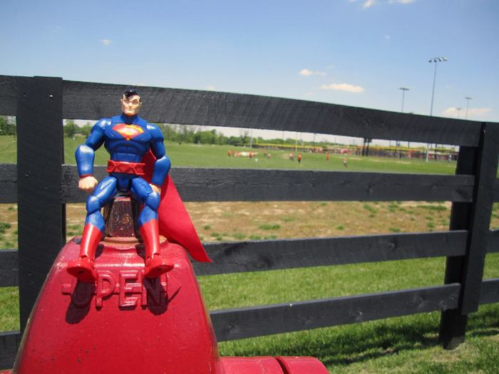 May 20th: Superman with a baseball game in the background