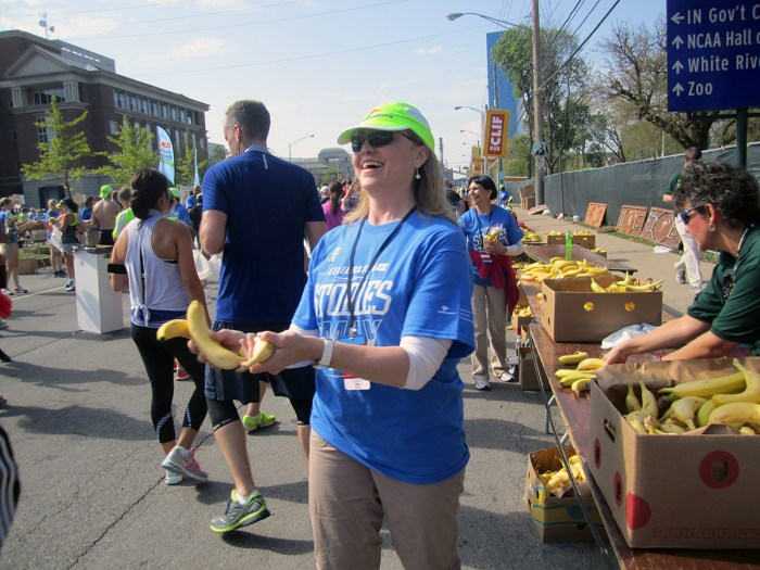 April 27th: Woman giving out bananas after the Mini Marathon