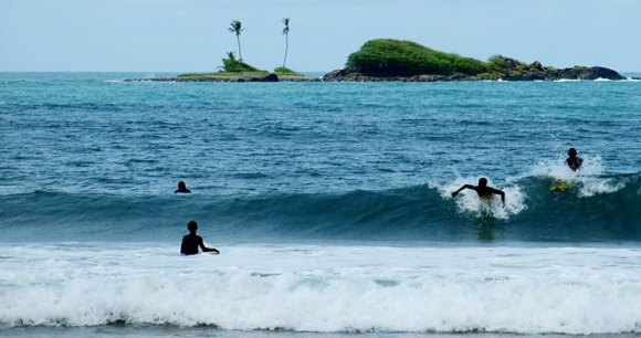 Busua Beach – one of Ghana's surfing hotspots © Michal Vogt, Wikimedia Commons