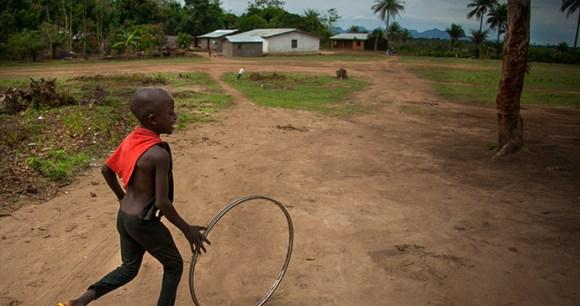 Boy playing Sierra Leone by robertonencini, Shutterstock
