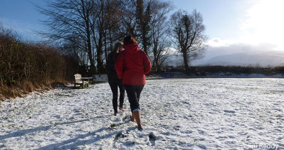 Jini and Lynne walking barefoot by Jini Reddy