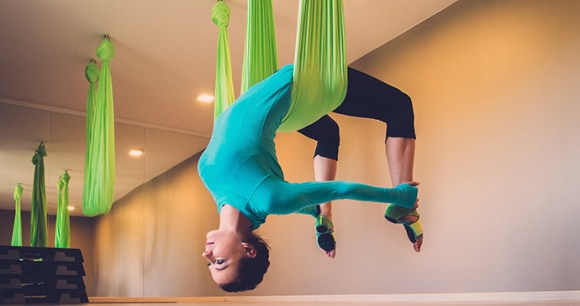Aerial yoga England UK by Nejron Photo Shutterstock
