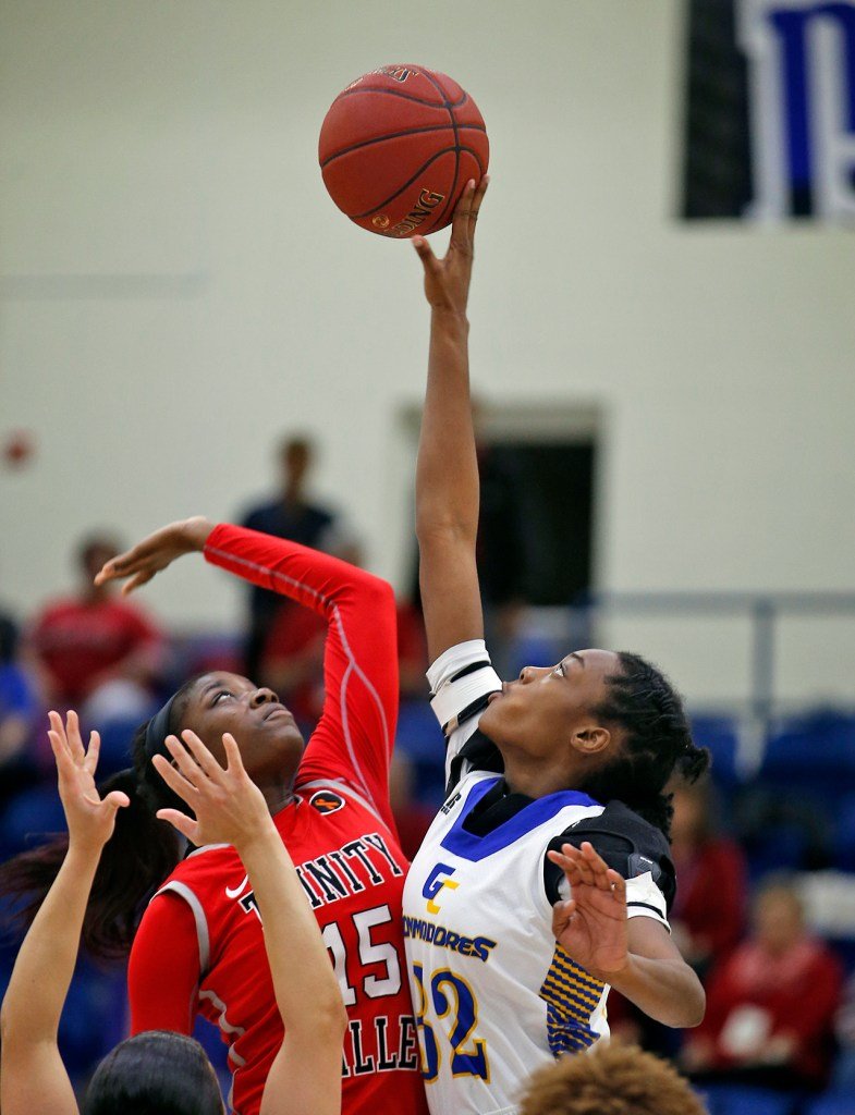 Jhileiya Dunlap and Malayasia McHenry tip off the basketball