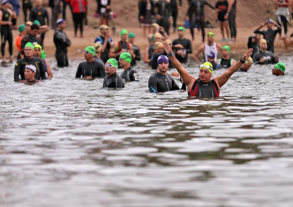 A contestant waves at the crowd while warming up before the Ironman 70.3 Buffalo Springs Lake, Sunday, June 25, 2017, at Buffalo Springs Lake in Buffalo Springs, Texas. (Brad Tollefson/A-J Media)