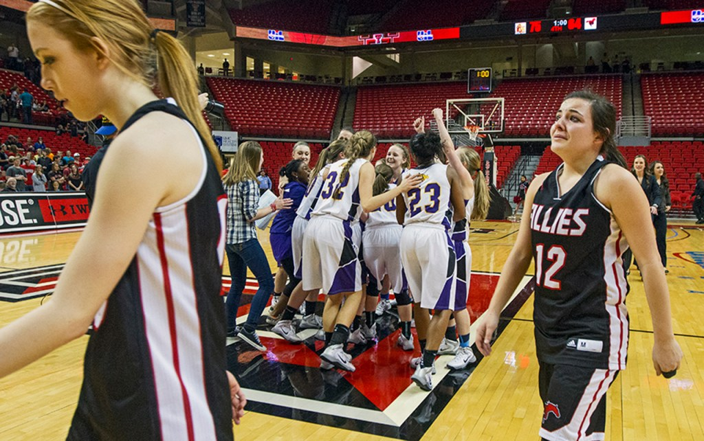 Wylie Lady Bulldogs celebrate after their 75-64 victory against Shallowater during the UIL Region 1 Finals on Feb. 22, 2014, in the United Spirit Arena in Lubbock, Texas