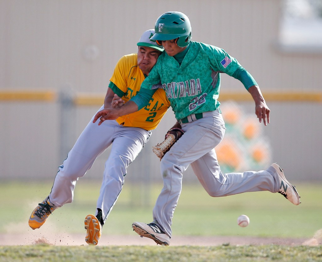 Floydada's Abraham Perez runs into New Deal's Cipriano Barajas as he misses the ball during New Deal's game against Floydada on Tuesday, April 5, 2016, in New Deal, Texas.