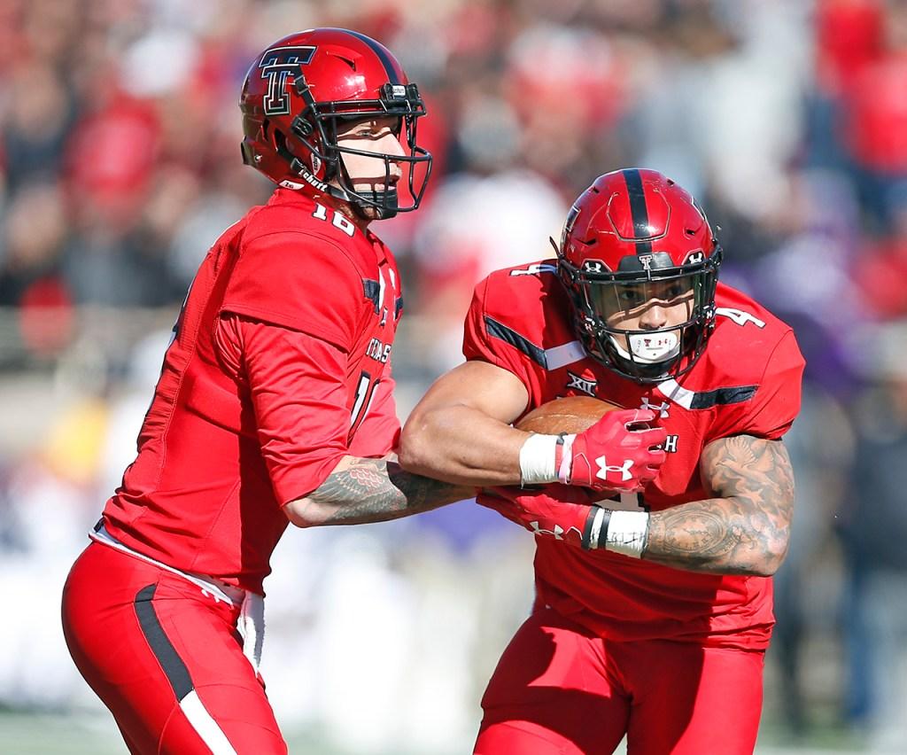 Texas Tech's Nic Shimonek hands the ball off to Justin Stockton