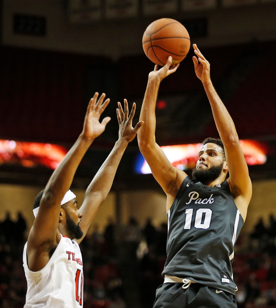 Nevada's Caleb Martin (10) shoots the ball over Texas Tech's Niem Stevenson (10) during the first half of the NCAA college basketball game Tuesday, Dec. 5, 2017, in Lubbock, Texas. (AP Photo/Brad Tollefson)