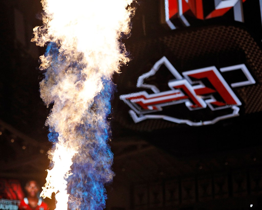 Flames shoot out into the air before an NCAA college basketball game Wednesday, Jan. 31, 2018, in Lubbock, Texas. (AP Photo/Brad Tollefson)