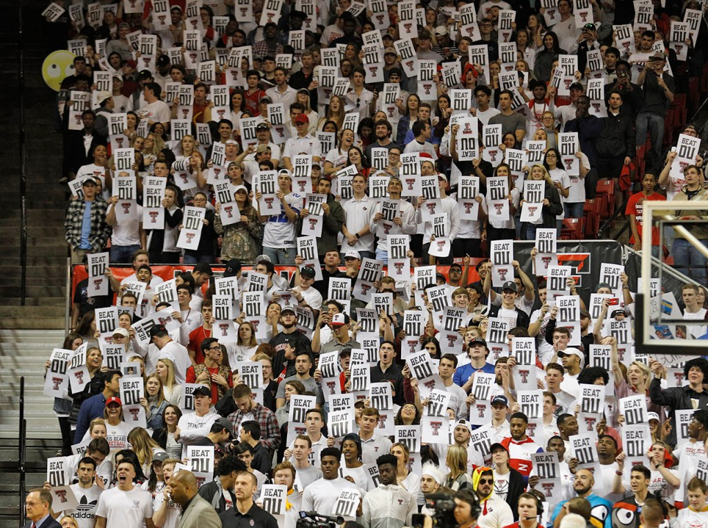Texas Tech fans hold up posters as the Oklahoma players are called before an NCAA college basketball game Tuesday, Feb. 13, 2018, in Lubbock, Texas. (AP Photo/Brad Tollefson)