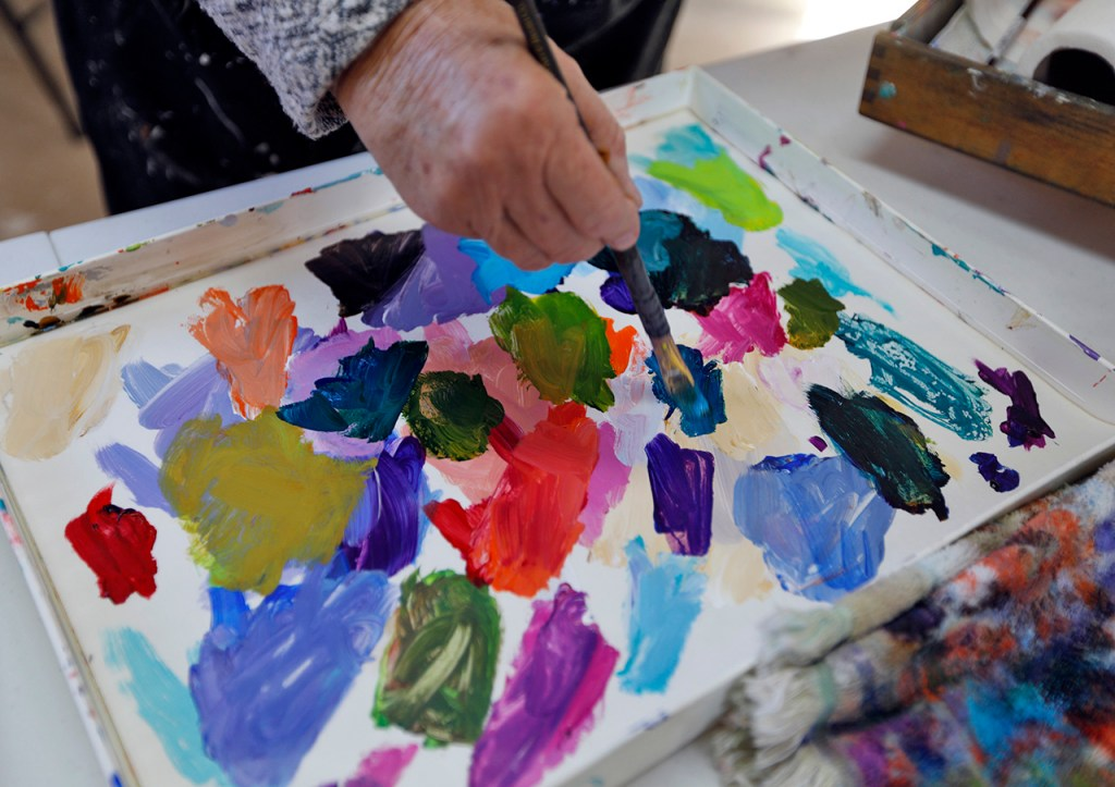 Dyan Newton works on a painting titled Country Living, Monday, March 5, 2018, inside her studio in Abernathy, Texas. Newton focuses on bright watercolor and acrylic paintings. [Brad Tollefson/A-J Media]