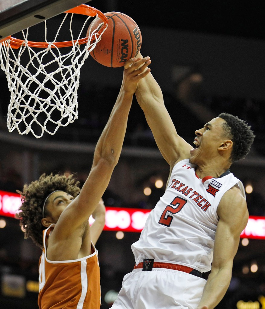 Texas Tech's Zhaire Smith (2) tries to dunk the ball around Texas' Jericho Sims (20) during a Big 12 basketball tournament game Thursday, March 8, 2018, at the Sprint Center in Kansas City, Mo. [Brad Tollefson/A-J Media]