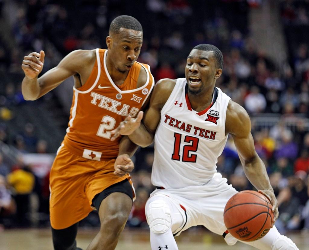 Texas Tech's Keenan Evans (12) drives the ball around Texas' Matt Coleman (2) during a Big 12 basketball tournament game Thursday, March 8, 2018, at the Sprint Center in Kansas City, Mo. [Brad Tollefson/A-J Media]