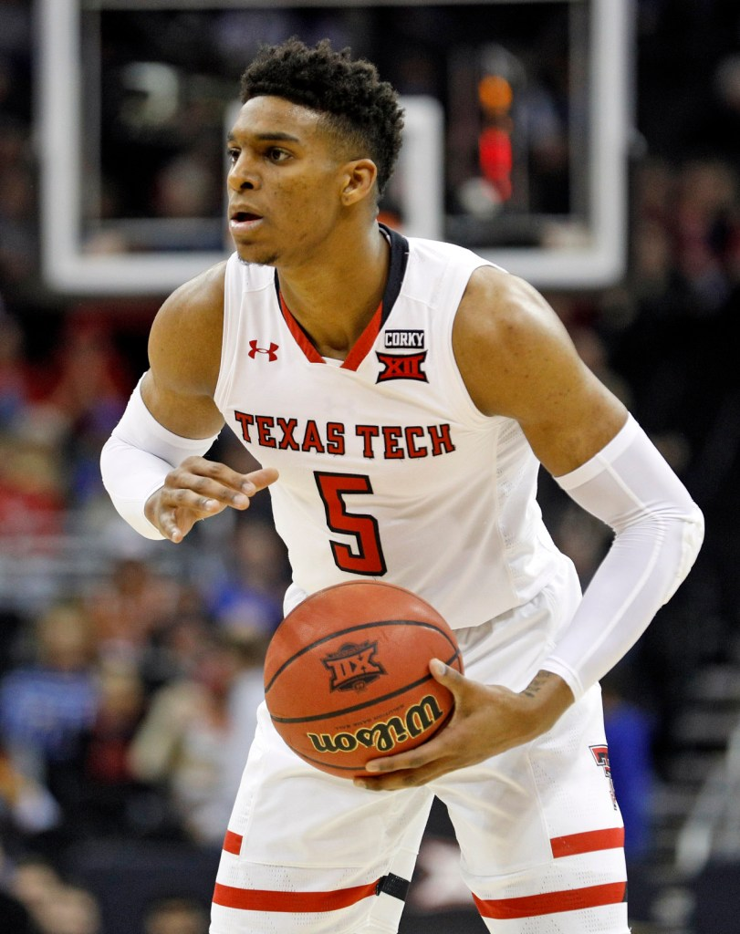 Texas Tech's Justin Gray (5) looks to pass the ball during a Big 12 basketball tournament game against Texas, Thursday, March 8, 2018, at the Sprint Center in Kansas City, Mo. [Brad Tollefson/A-J Media]