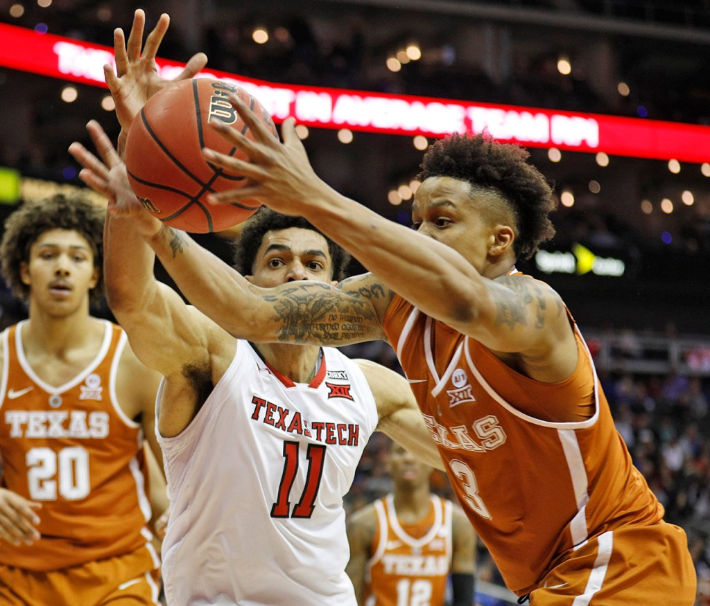 Texas Tech's Zach Smith (11) and Texas' Jacob Young (3) reach out for the loose ball during a Big 12 basketball tournament game Thursday, March 8, 2018, at the Sprint Center in Kansas City, Mo. [Brad Tollefson/A-J Media]