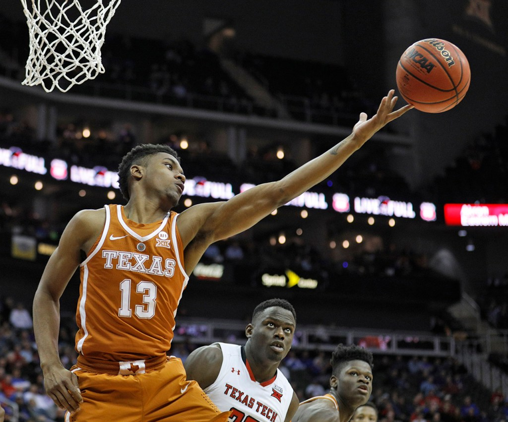 Texas' Jase Febres (13) tries to rebound the ball during a Big 12 basketball tournament game against Texas Tech, Thursday, March 8, 2018, at the Sprint Center in Kansas City, Mo. [Brad Tollefson/A-J Media]