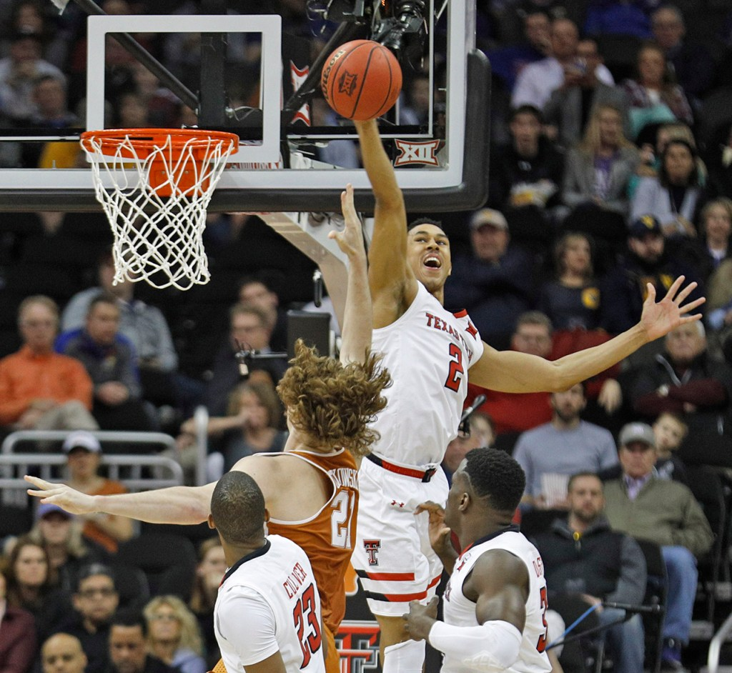 Texas Tech's Zhaire Smith (2) blocks a shot Texas' Dylan Osetkowski (21) during a Big 12 basketball tournament game Thursday, March 8, 2018, at the Sprint Center in Kansas City, Mo. [Brad Tollefson/A-J Media]