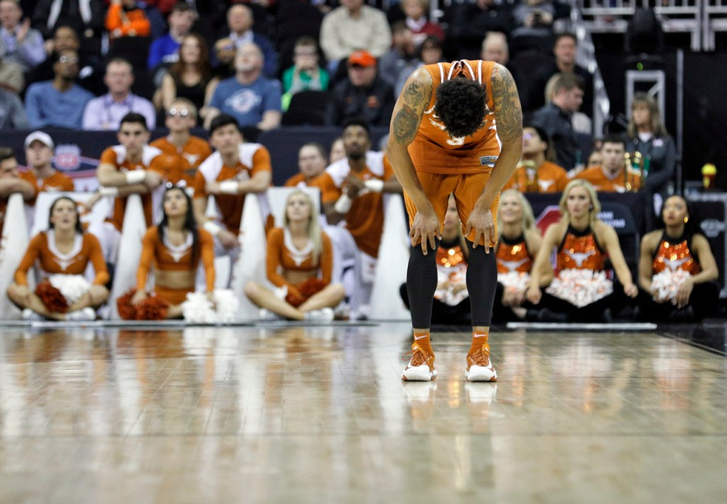 Texas' Jacob Young (3) bends over during a Big 12 basketball tournament game against Texas Tech, Thursday, March 8, 2018, at the Sprint Center in Kansas City, Mo. [Brad Tollefson/A-J Media]