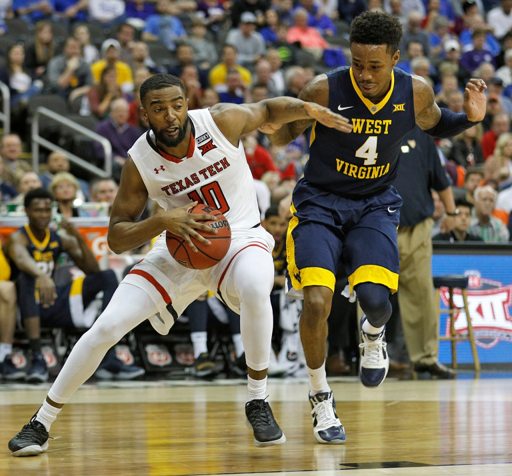Texas Tech's Niem Stevenson (10) turns in front of West Virginia's Daxter Miles (4) during a Big 12 semifinal game Friday, March 9, 2018, at the Sprint Center in Kansas City, Mo. [Brad Tollefson/A-J Media]