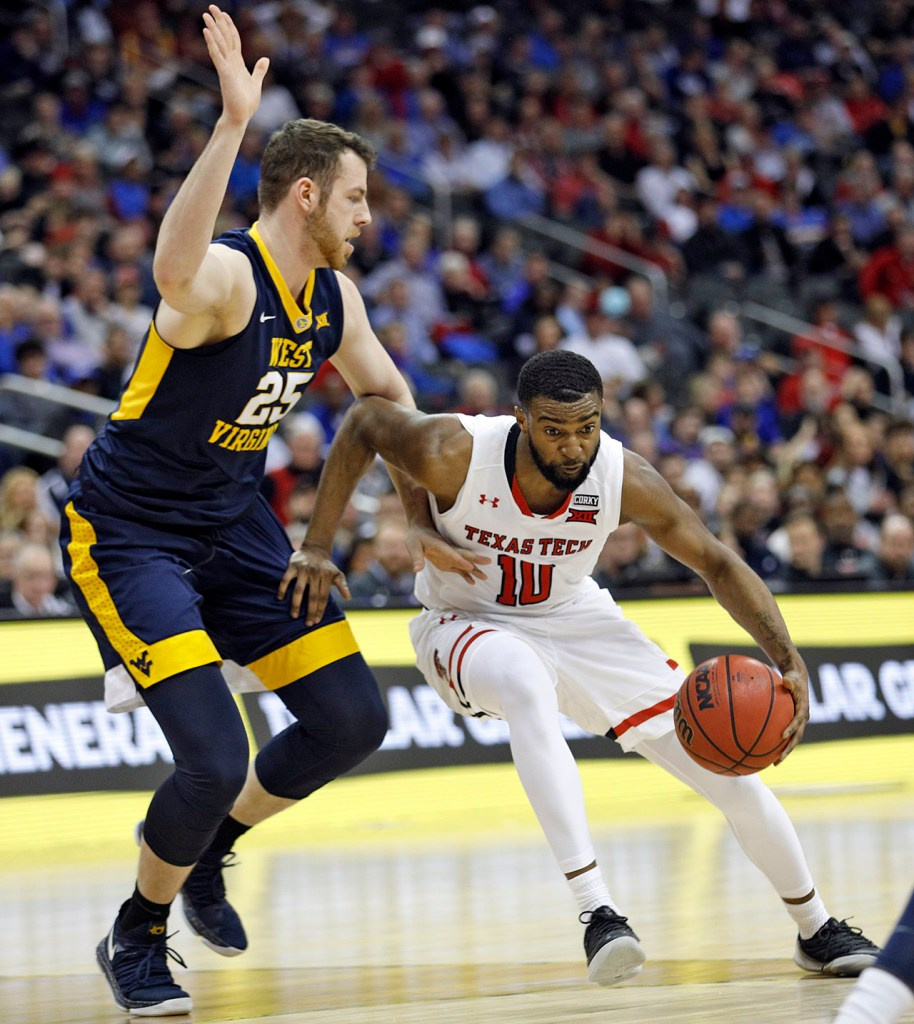 Texas Tech's Niem Stevenson (10) drives the ball around West Virginia's Maciej Bender (25) during a Big 12 semifinal game Friday, March 9, 2018, at the Sprint Center in Kansas City, Mo. [Brad Tollefson/A-J Media]