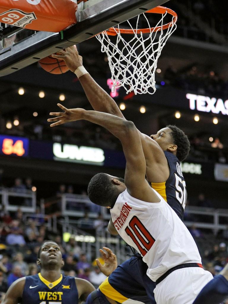 West Virginia's Sagaba Konate (50) blocks a shot by Texas Tech's Niem Stevenson (10) during a Big 12 semifinal game Friday, March 9, 2018, at the Sprint Center in Kansas City, Mo. [Brad Tollefson/A-J Media]
