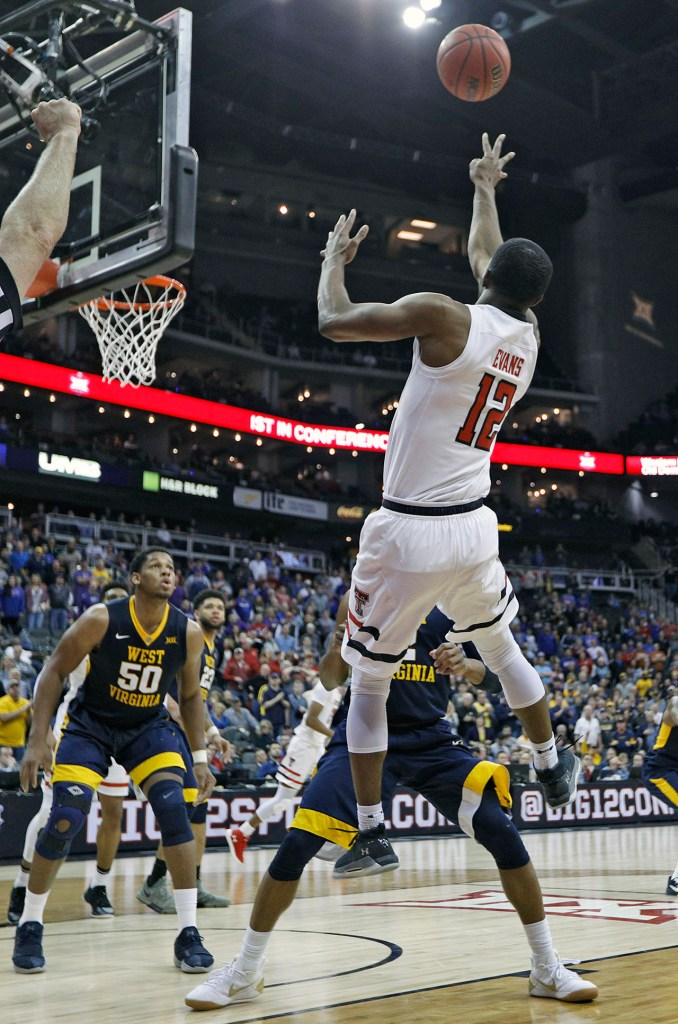 Texas Tech's Keenan Evans (12) shoots the ball over West Virginia's Jevon Carter (2) during a Big 12 semifinal game Friday, March 9, 2018, at the Sprint Center in Kansas City, Mo. [Brad Tollefson/A-J Media]