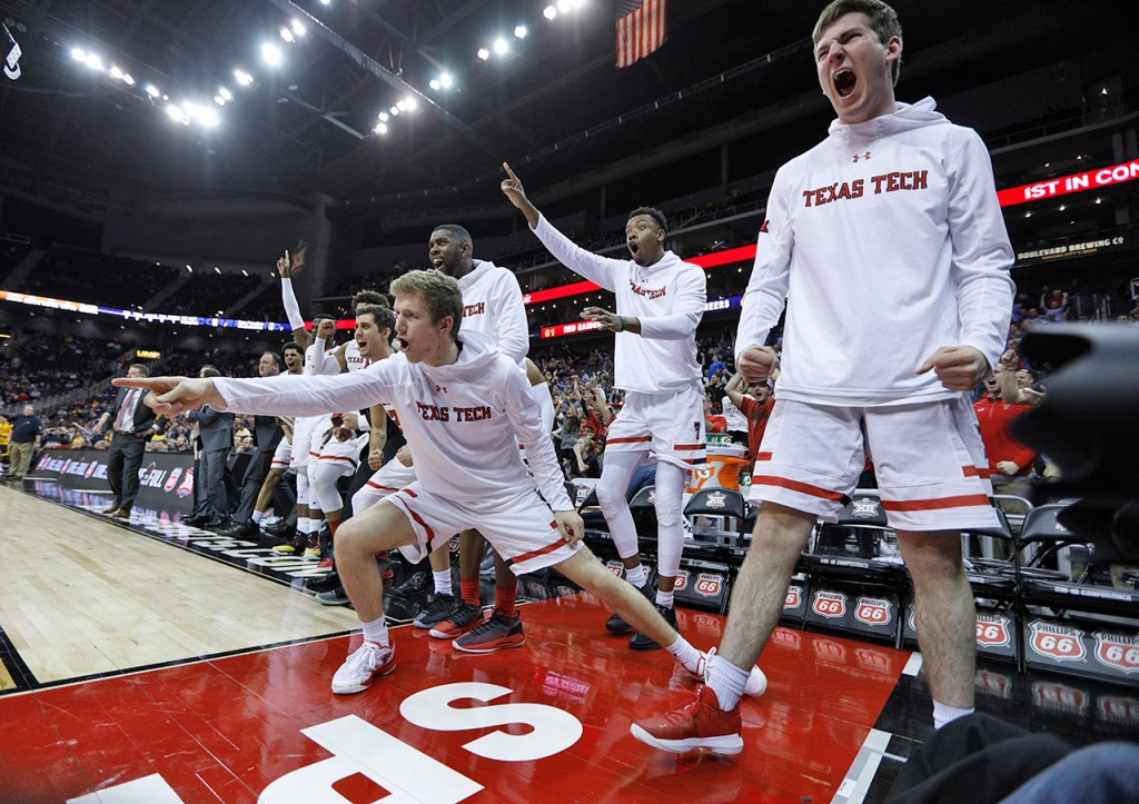 The Texas Tech bench celebrates after Keenan Evans (12) scored while being fouled during a Big 12 semifinal game against West Virginia, Friday, March 9, 2018, at the Sprint Center in Kansas City, Mo. [Brad Tollefson/A-J Media]