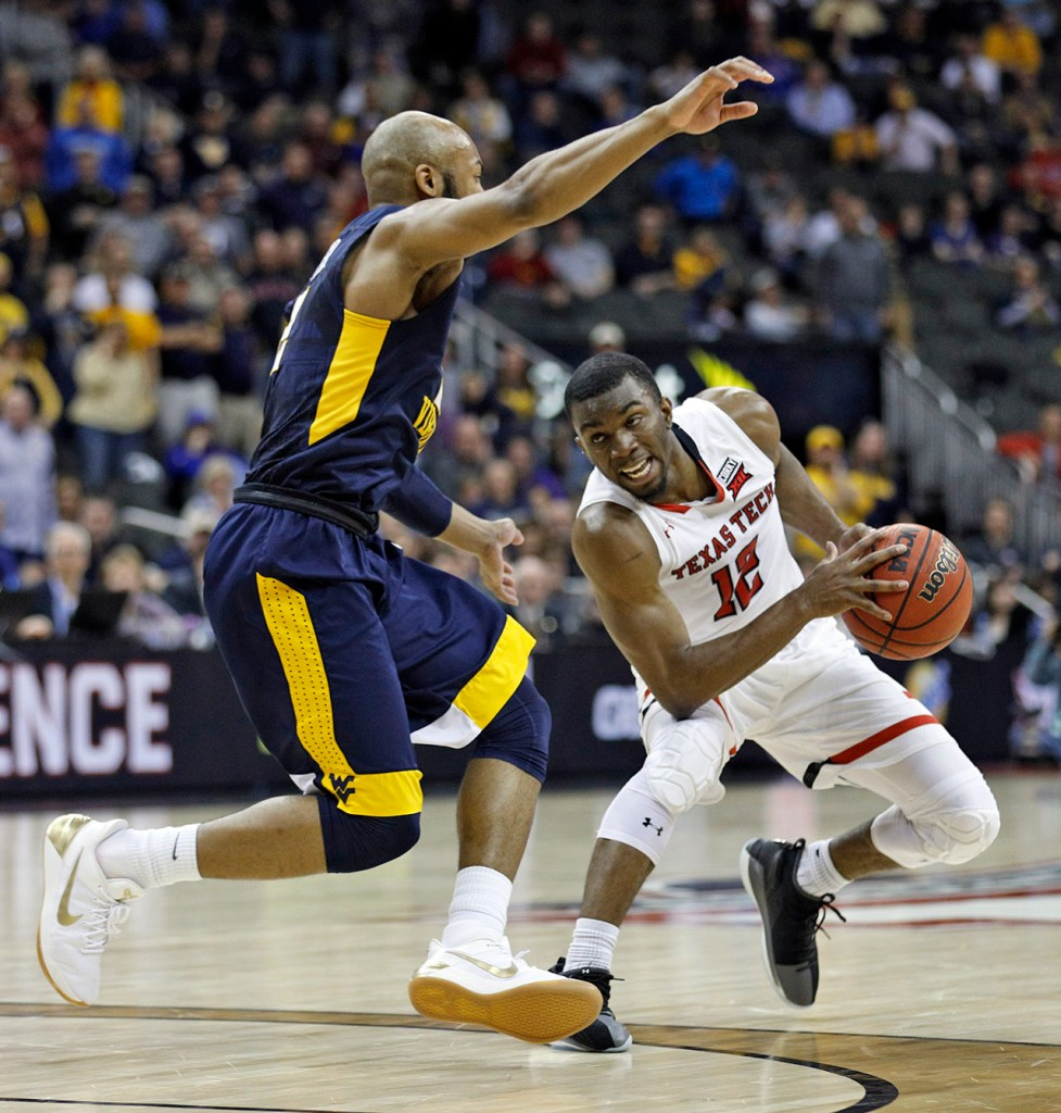 Texas Tech's Keenan Evans (12) jumps back from West Virginia's Jevon Carter (2) during a Big 12 semifinal game Friday, March 9, 2018, at the Sprint Center in Kansas City, Mo. [Brad Tollefson/A-J Media]