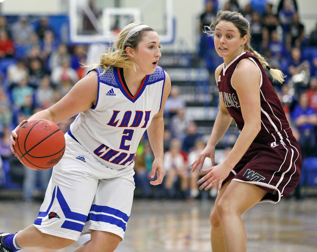 Lubbock Christian's Caitlyn Cunyus (2) drives the ball around West Texas A&M's Lexy Hightower (4) during the South Central regional championship Monday, March 12, 2018, at Rip Griffin Center in Lubbock, Texas. [Brad Tollefson/A-J Media]