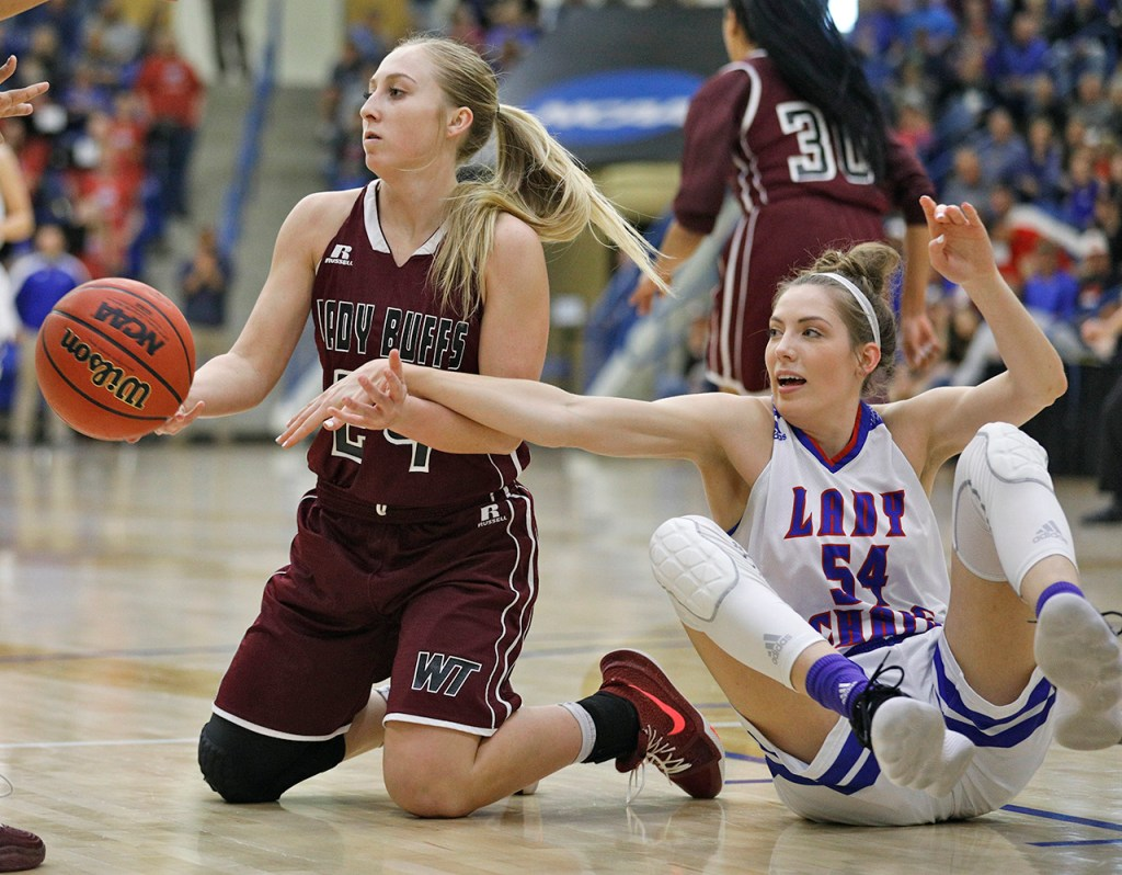West Texas A&M's Reagan Haynes (24) steals the ball from Lubbock Christian's Tess Bruffey (54) during the South Central regional championship Monday, March 12, 2018, at Rip Griffin Center in Lubbock, Texas. [Brad Tollefson/A-J Media]