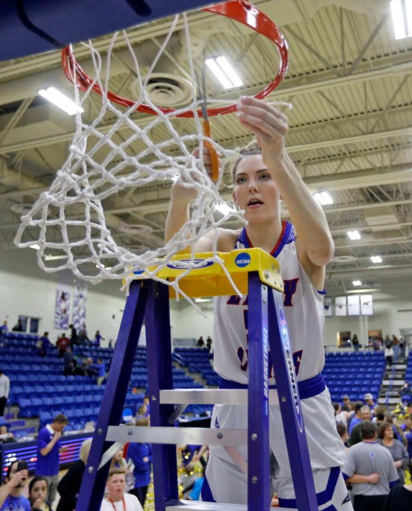 Lubbock Christian's Tess Bruffey (54) cuts down a piece of the net after the South Central regional championship against West Texas A&M, Monday, March 12, 2018, at Rip Griffin Center in Lubbock, Texas. [Brad Tollefson/A-J Media]