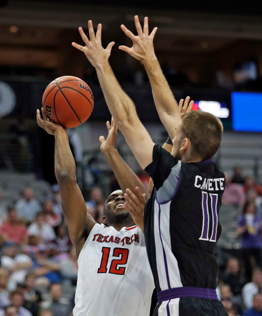 Texas Tech's Keenan Evans (12) shoots the ball over Stephen F. Austin's Ivan Canete (11) during an NCAA college basketball tournament first-round game Thursday, March 15, 2018, at American Airlines Center in Dallas, Texas. [Brad Tollefson/A-J Media]
