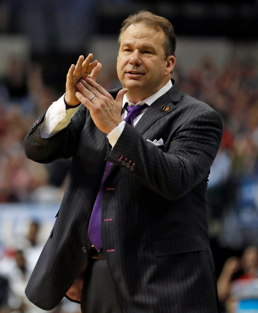 Stephen F. Austin coach Kyle Keller calls for a timeout during an NCAA college basketball tournament first-round game Thursday, March 15, 2018, at American Airlines Center in Dallas, Texas. [Brad Tollefson/A-J Media]
