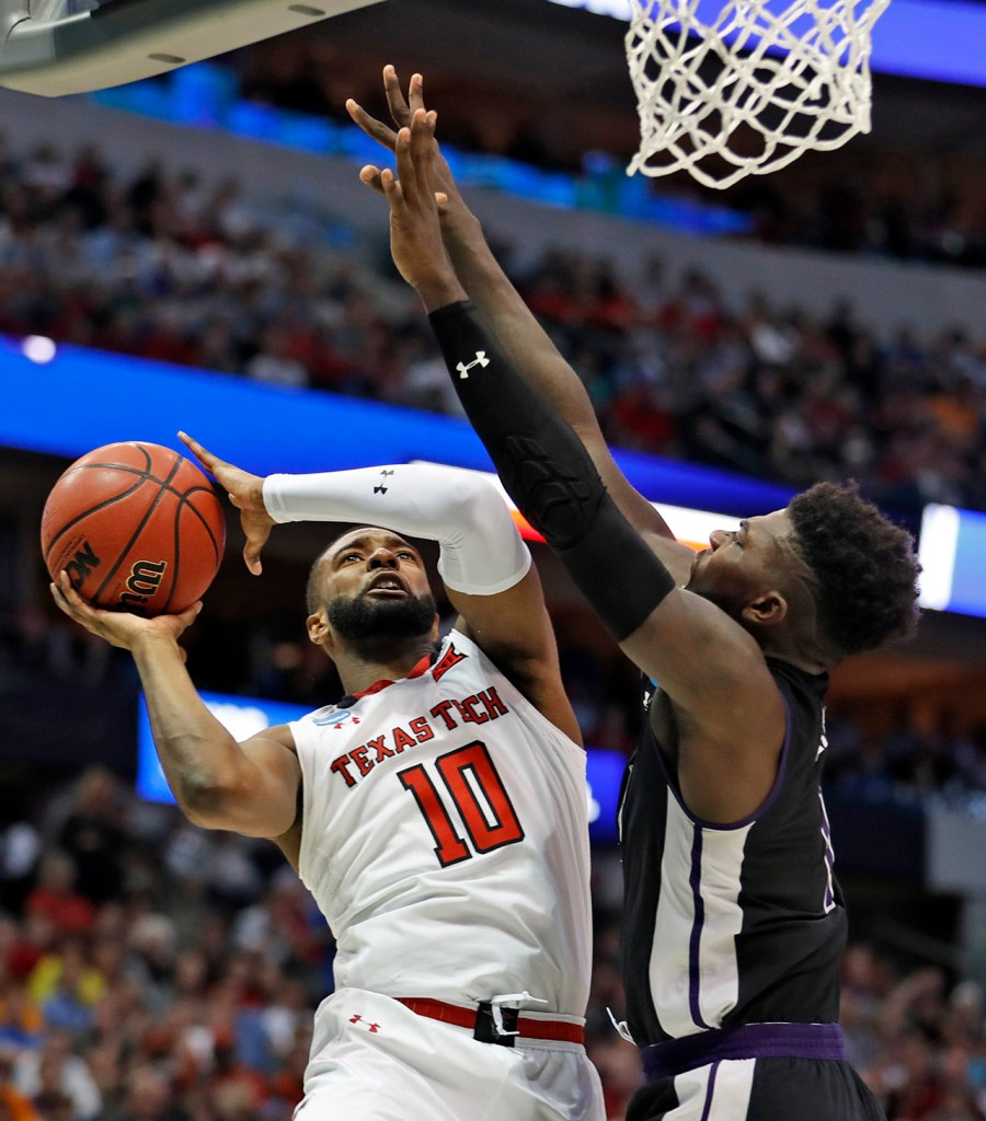 Texas Tech's Niem Stevenson (10) shoots the ball over Stephen F. Austin's Kevon Harris (1) during an NCAA college basketball tournament first-round game Thursday, March 15, 2018, at American Airlines Center in Dallas, Texas. [Brad Tollefson/A-J Media]