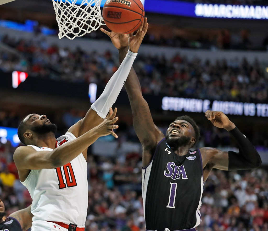 Texas Tech's Niem Stevenson (10) tries to lay up the ball around Stephen F. Austin's Kevon Harris (1) during an NCAA college basketball tournament first-round game Thursday, March 15, 2018, at American Airlines Center in Dallas, Texas. [Brad Tollefson/A-J Media]