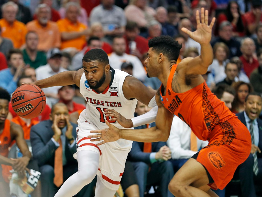 Texas Tech's Niem Stevenson (10) drives the ball around Florida's Jalen Hudson (3) during an NCAA college basketball tournament second-round game Saturday, March 17, 2018 at American Airlines Center in Dallas, Texas. [Brad Tollefson/A-J Media]