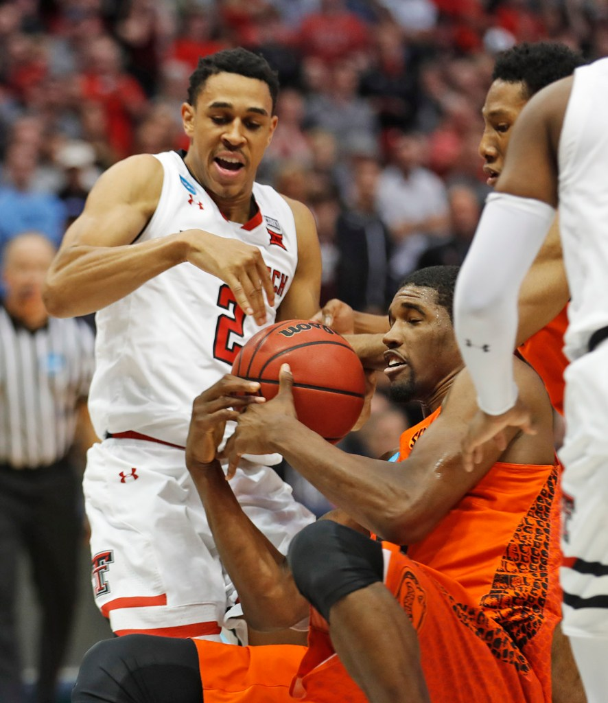 Florida's Kevarrius Hayes (13) steals the ball from Texas Tech's Zhaire Smith (2) during an NCAA college basketball tournament second-round game Saturday, March 17, 2018 at American Airlines Center in Dallas, Texas. [Brad Tollefson/A-J Media]