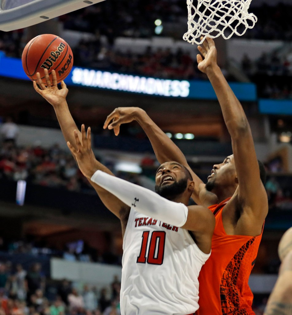 Texas Tech's Niem Stevenson (10) lays up the ball around Florida's Kevarrius Hayes (13) during an NCAA college basketball tournament second-round game Saturday, March 17, 2018 at American Airlines Center in Dallas, Texas. [Brad Tollefson/A-J Media]