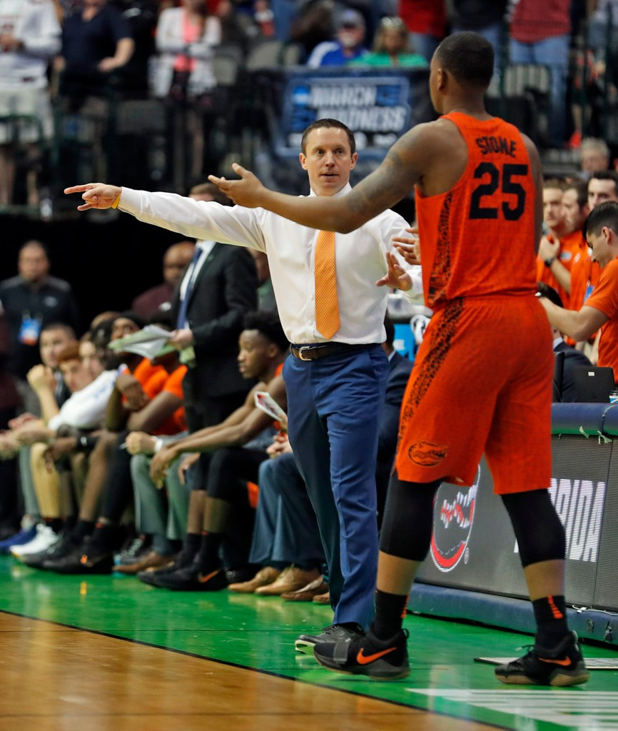 Florida coach Mike White talks to Keith Stone (25) during an NCAA college basketball tournament second-round game Saturday, March 17, 2018 at American Airlines Center in Dallas, Texas. [Brad Tollefson/A-J Media]