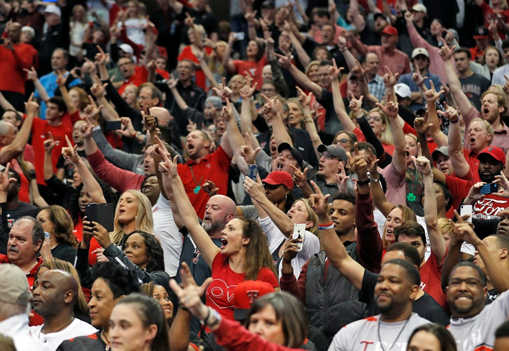 Texas Tech fans celebrate after an NCAA college basketball tournament second-round game against Florida, Saturday, March 17, 2018, at American Airlines Center in Dallas, Texas. [Brad Tollefson/A-J Media]